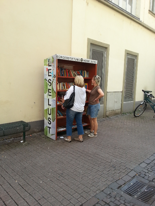 People browsing the free books where we live.