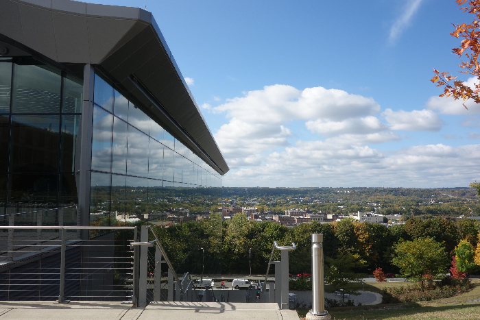 The reflection of the city in the glass of the EMPAC building.