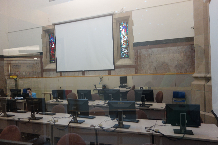 Stained glass windows among computers.