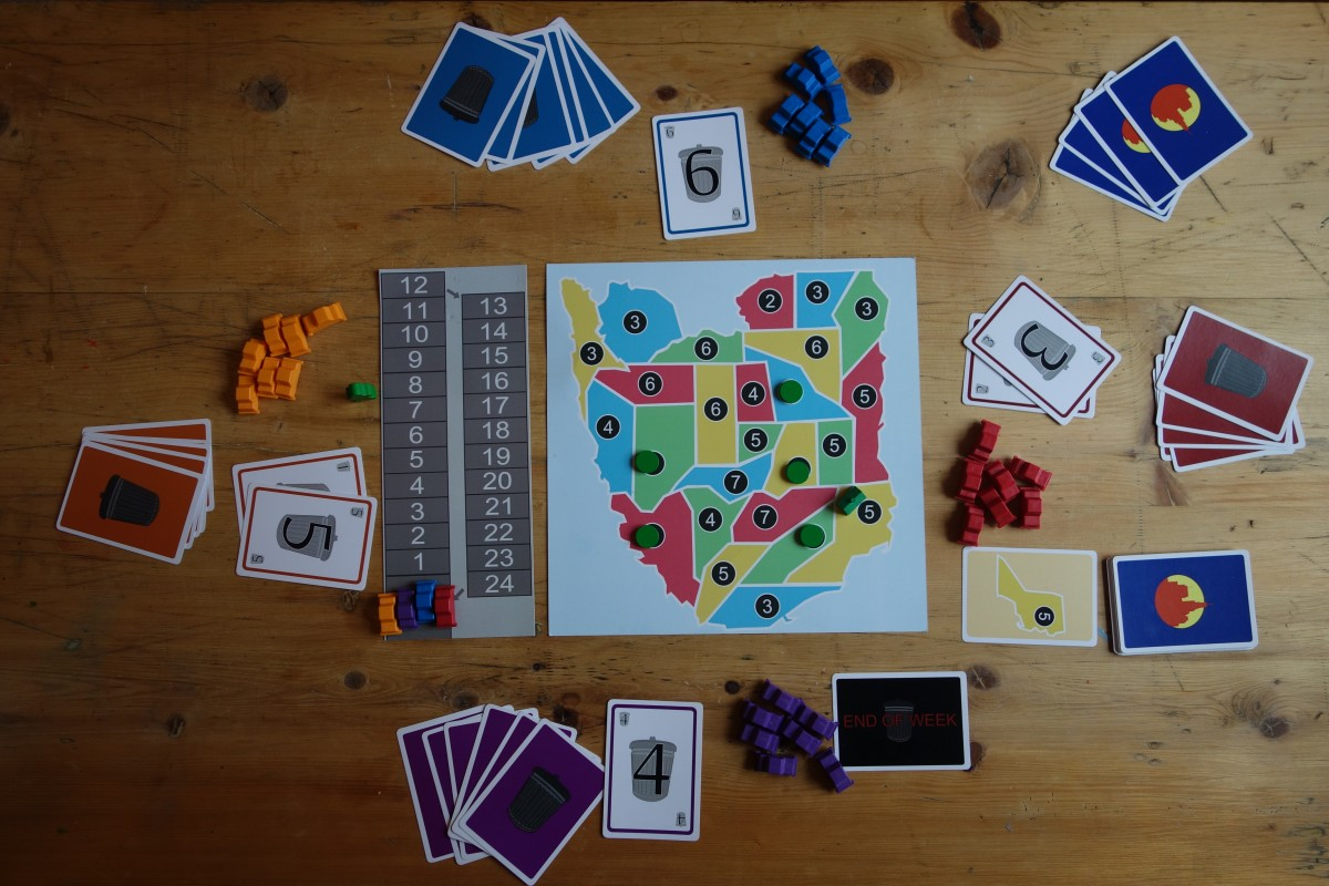 Sanitation Nation during a biding phase. Each player reveals how much money they will pay to acquire the contract for the current city.